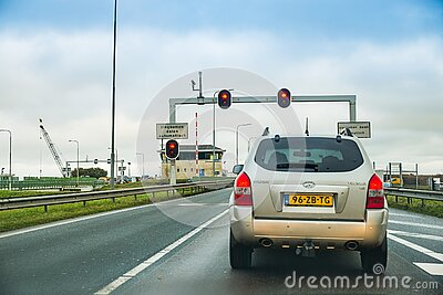 Den Oever, Netherlands - January 09, 2020. Cars waiting on traffic lights before water chanell