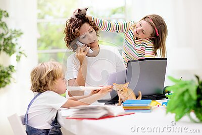 Mother working from home with kids. Quarantine