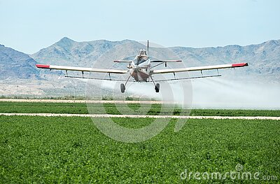 Crop duster over alfalfa in the Mohave Valley