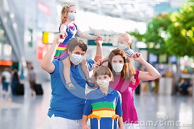Family in airport in face mask. Virus outbreak