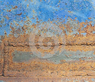 Old blue metal case with rust in the welds