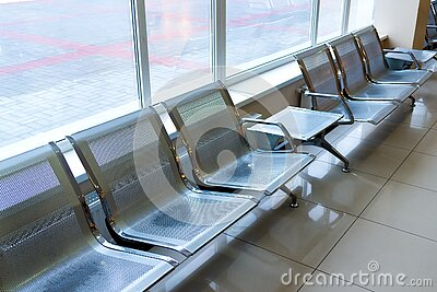 Airport gate waiting area with metal seats