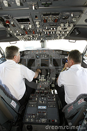 Airplane pilots in cockpit preparing to takeoff
