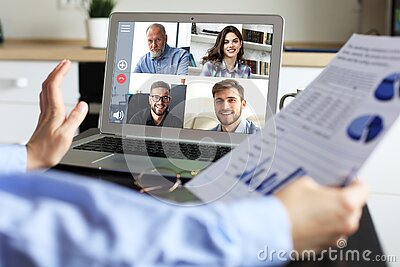Business woman talking to her colleagues in video conference. Business team working from home using laptop