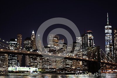 New York City empty streets. NYC skyline with Brooklyn bridge at night