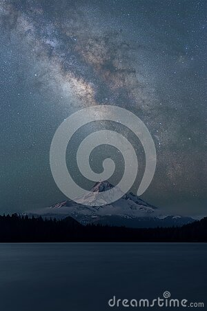 Milky Way Galaxy in West Coast, United States. Stars in the night sky and Mount Hood reflecting in Lost Lake at night.