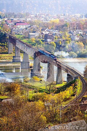 Railway bridge over the river. A train crosses a river. Nice view of the countryside. View from above.