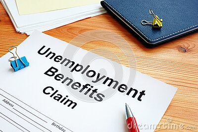 Unemployment benefits claim and stack of papers