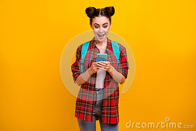 Photo of beautiful amazed student lady hold telephone freelance work and study read salary email walk college wear bag