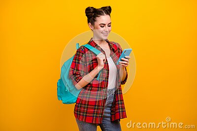 Photo of beautiful student lady hold telephone combine freelance work and study read job email wear blue bag casual