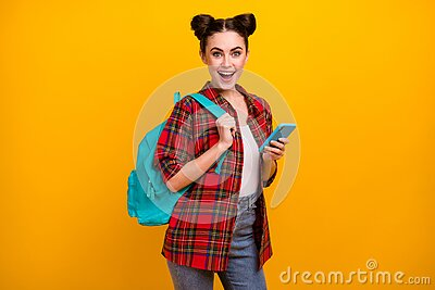 Photo of beautiful amazed student lady hold telephone combine freelance work study read salary income email wear bag