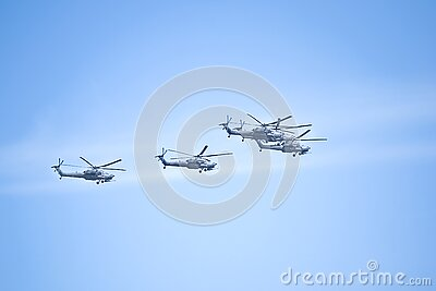 Fighters, flying helicopters at The Victory Day military parade.