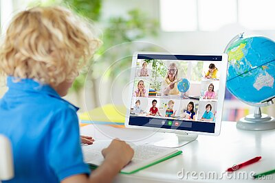 Online remote learning. School kids with computer