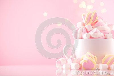 Marshmallow. Close-up of Marshmallows colorful chewy candy, over pink bokeh background, closeup. Sweet holiday food dessert