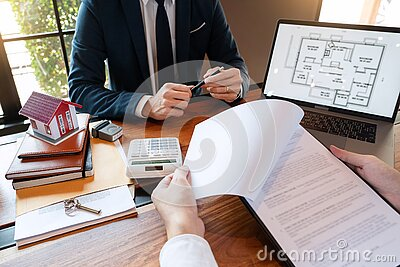 Buy or sell real estate concept, Sale representative offer house purchase contract to buy a house or apartment and give home key c