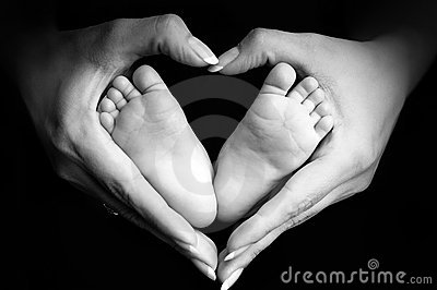 Baby's feet in mom's palms