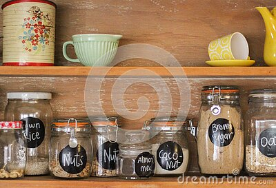 Wooden Antique Kitchen Hutch with jars of baking ingredients and retro crockery