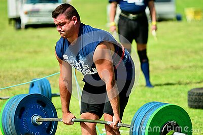 Auckland, New Zealand - Mar 2020. Strongman training in a public park, log Lift and Deadlift training