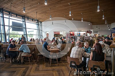 People inside shopping mall centre service station food court open plan area
