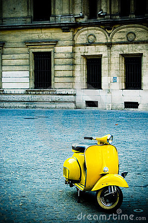 Yellow scooter in plaza