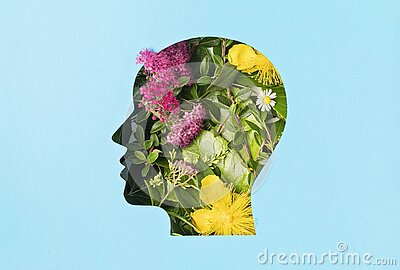 Papercut head with green leaves and flowers. Mental health, emotional wellness, contented emotions, self care, psychology, green