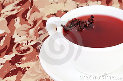 Cup of Herbal Red Tea with Petals