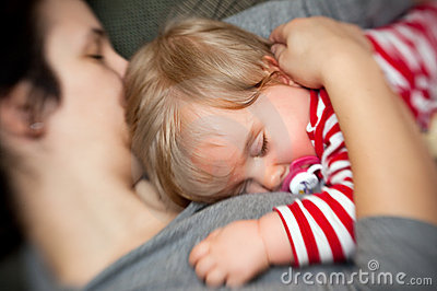 Mother hold sleeping baby
