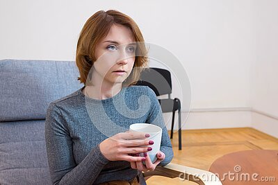 Young woman on the couch in a psychologists office. Consultations with a doctor. Psychology, psychotherapy, concept of help and