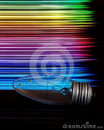 The light bulb is wet on the table and on the back are multi-colored stripes in the form of a rainbow. art photo