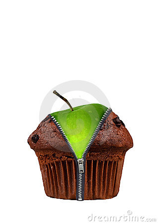 An apple in a chocolate cup cake