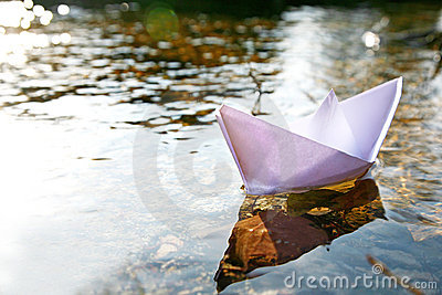 Paper ship in the lake