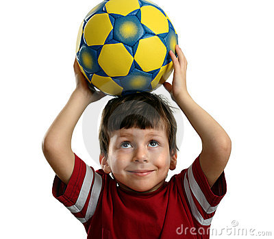 Beautiful child holds a soccer ball over his head
