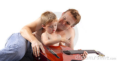 stock image of proud father teaching his son