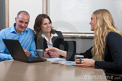 Caucasian businesswoman giving advise to couple
