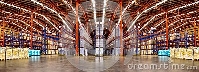 Warehouse industrial and logistics companies. Commercial warehouse. Huge distribution warehouse with high shelves.