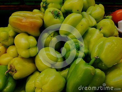 Raw Sweet Peppers are ready for cooking. Green background