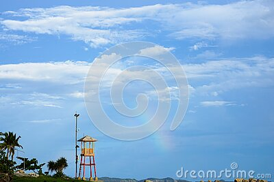 Observation small tower for lifeguard with rainbow seaside