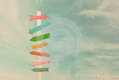Colorful wooden direction arrow signs