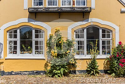 Facde of a historic yellow house in Ribe