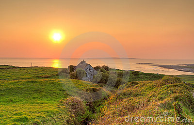 Irish cottage house at sunset