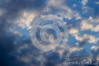 Low angle wide view of beautiful blue sky covered with clouds and sunlight reflecting from them