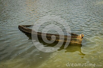 Old wrecked boat submerged in lake