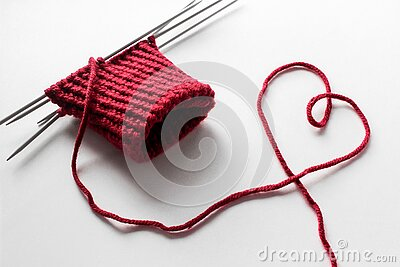 Unfinished wool and knitting needle design. Red thread and tangle. Handmade concept. Craft banner. Love, romantic, valentines day
