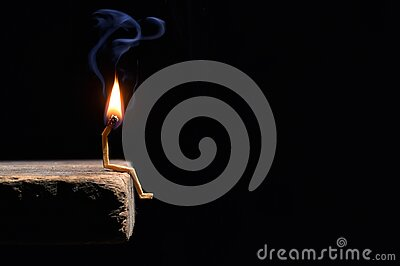 Conceptual burned out wooden matches on black background