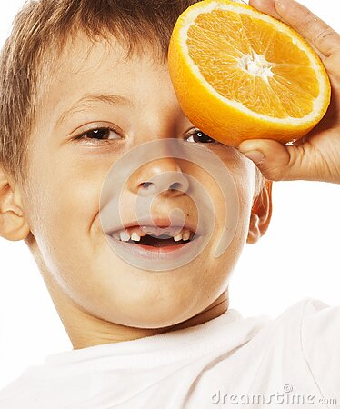 Little cute boy with orange fruit double isolated on white smiling without front teeth adorable kid cheerful