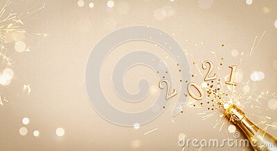 Creative Christmas and New Year greeting card with golden champagne bottle, confetti stars and 2021 numbers. Flat lay. Banner.