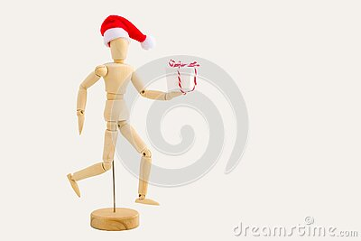 Running wooden figure with gift box on white background