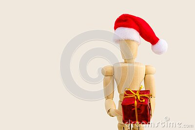 Wooden figure with gift box on white background