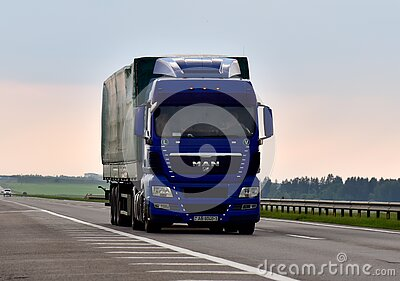 MAN truck with Semi-trailer driving along highway. Goods Delivery by roads. Services and Transport logistics. BELARUS, MINSK - JUN