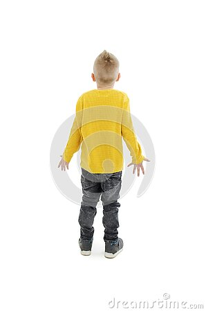 Back view of young boy confusing. Shocked little boy with hands up.